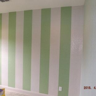 Design ideas for a medium sized romantic gender neutral nursery in Austin with multi-coloured walls and medium hardwood flooring.