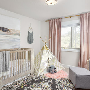 This is an example of a traditional nursery for girls in Portland with grey walls, carpet and grey floors.