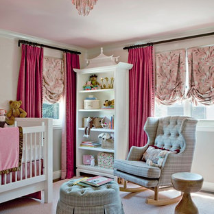 Classic nursery for girls in Los Angeles with carpet and beige floors.