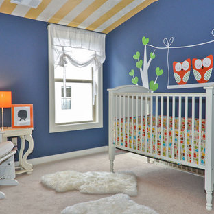 Design ideas for a small bohemian gender neutral nursery in Birmingham with blue walls and carpet.