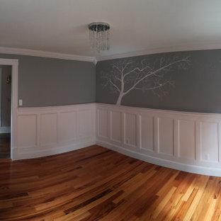 Design ideas for a medium sized classic nursery for girls in Manchester with grey walls, medium hardwood flooring and orange floors.