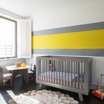 Nursery - contemporary gender-neutral dark wood floor nursery idea in New York with multicolored walls