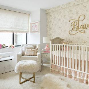 Medium sized classic nursery for girls in New York with carpet, beige walls and beige floors.