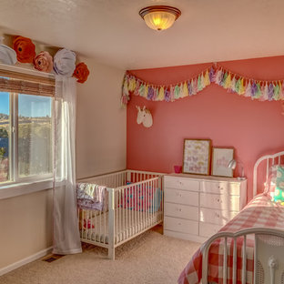 Design ideas for a medium sized eclectic nursery for girls in Other with pink walls, carpet and beige floors.