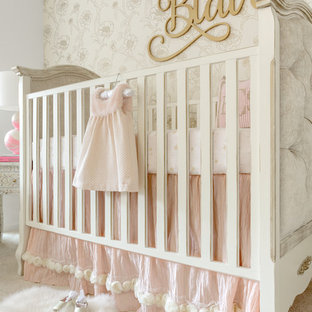 This is an example of a medium sized traditional nursery for girls in New York with carpet.