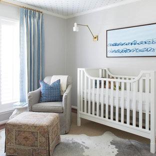 Design ideas for a medium sized beach style nursery for boys in Houston with grey walls and dark hardwood flooring.