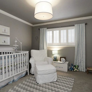 Design ideas for a medium sized traditional nursery for boys in Nashville with grey walls, carpet and grey floors.