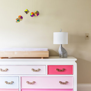 Inspiration for a transitional girl light wood floor nursery remodel in Other with beige walls