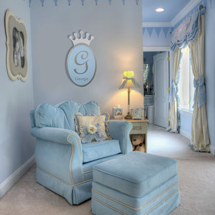 Photo of a large classic gender neutral nursery in New York with blue walls, carpet and white floors.