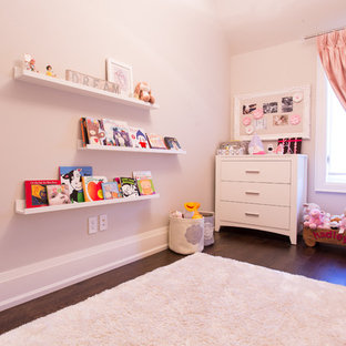 Inspiration for a traditional nursery for girls in Toronto with dark hardwood floors.