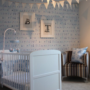 Design ideas for a traditional nursery for boys in London with blue walls and carpet.