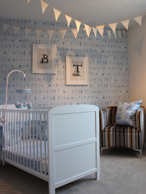 Inspiration for a timeless boy carpeted nursery remodel in London with blue  walls