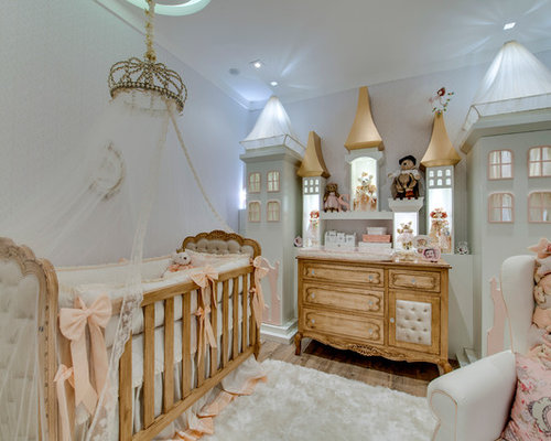 Mid-sized traditional girl medium tone wood floor nursery idea in Other  with beige walls