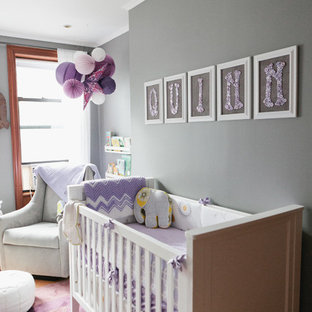 Photo of a medium sized bohemian nursery for girls in New York with grey walls and light hardwood flooring.