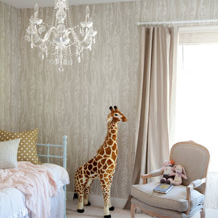 Photo of an eclectic nursery for girls in Vancouver with beige walls and carpet.