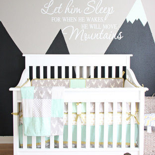 Design ideas for a large classic nursery for boys in Austin with grey walls and light hardwood flooring.
