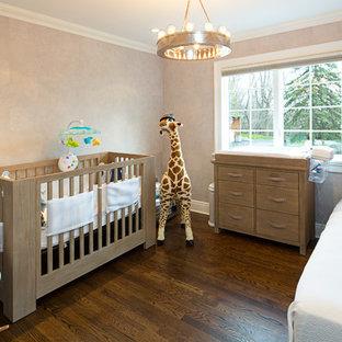 Classic gender neutral nursery in New York with grey walls, dark hardwood flooring and brown floors.