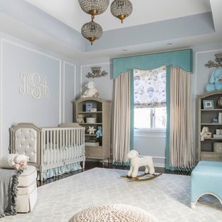 Inspiration for a large classic nursery for boys in New York with grey walls and vinyl flooring.
