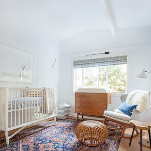 Trendy gender-neutral nursery photo in Los Angeles with white walls