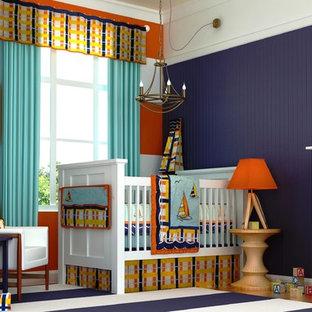 Cette photo montre une chambre de bébé garçon craftsman avec un mur bleu.