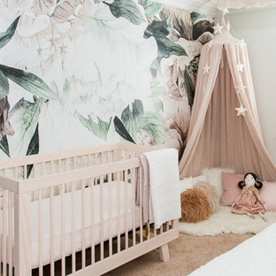 Danish girl carpeted and brown floor nursery photo in San Diego with white walls