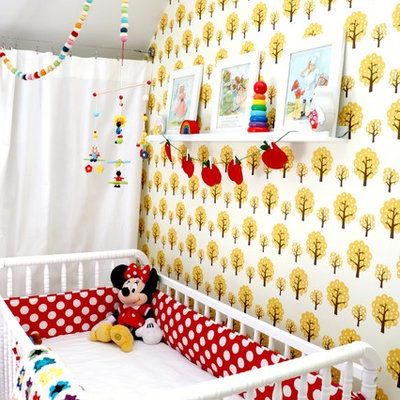 Inspiration for a mid-sized scandinavian girl painted wood floor nursery remodel in Las Vegas with white walls