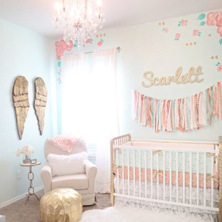 Small cottage chic girl carpeted nursery photo in Austin with multicolored walls