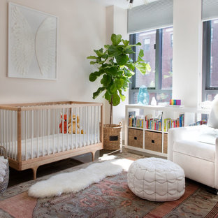 Photo of a classic nursery for girls in Boston with pink walls.