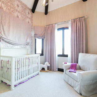 Design ideas for a medium sized nautical nursery for girls in Orange County with beige walls and carpet.