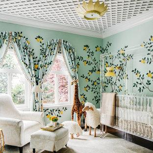 Imagen de habitación de bebé neutra clásica renovada, grande, con paredes verdes, suelo de madera oscura y suelo marrón