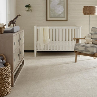 Photo of a mid-sized contemporary gender-neutral nursery in Other with beige walls, carpet and white floor.