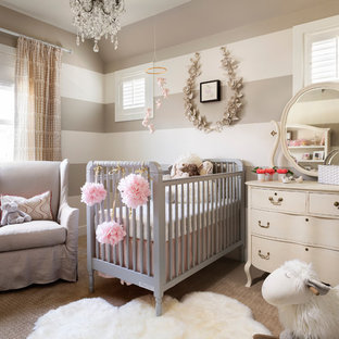 Nursery - mid-sized cottage girl carpeted and beige floor nursery idea in Denver with multicolored walls