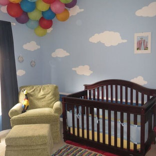 This is an example of a medium sized contemporary gender neutral nursery in Other with blue walls.