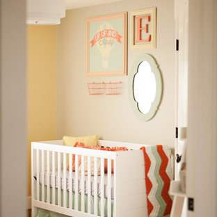 Medium sized eclectic nursery for girls in Salt Lake City with beige walls and carpet.