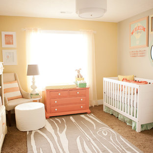 Inspiration for a medium sized eclectic nursery for girls in Salt Lake City with yellow walls and carpet.
