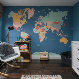 Medium sized contemporary nursery for boys in London with blue walls, dark hardwood flooring and brown floors.