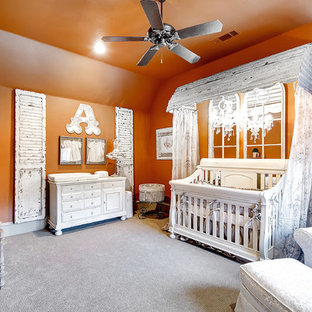 Example of a mid-sized transitional girl carpeted nursery design in Dallas with orange walls