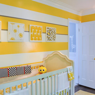 Transitional gender-neutral dark wood floor nursery photo in DC Metro with yellow walls