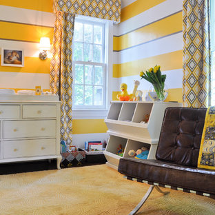 Nursery - transitional gender-neutral dark wood floor nursery idea in DC Metro with yellow walls
