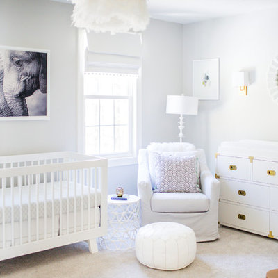 Mid-sized transitional girl carpeted and gray floor nursery photo in Boston with gray walls