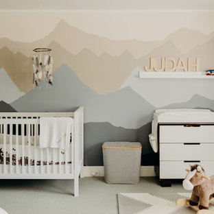 This is an example of a medium sized traditional gender neutral nursery in Portland with beige walls, carpet and beige floors.