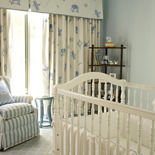 Transitional gender-neutral carpeted nursery photo in Los Angeles with blue walls