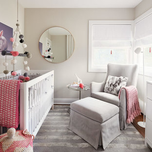Photo of a medium sized contemporary nursery for girls in Chicago with beige walls, medium hardwood flooring and brown floors.