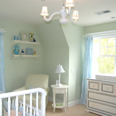 Nursery - mid-sized transitional gender-neutral carpeted and beige floor nursery idea in San Francisco with blue walls