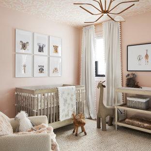 На фото: большая нейтральная комната для малыша в стиле современная классика с розовыми стенами и потолком с обоями с