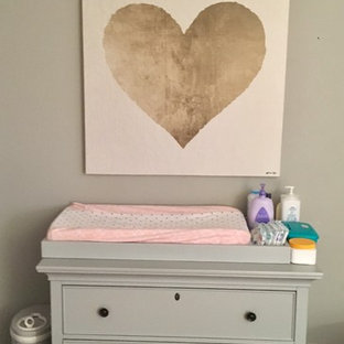 Inspiration for a medium sized traditional nursery for girls in Chicago with grey walls and bamboo flooring.