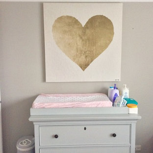 Design ideas for a medium sized traditional nursery for girls in Chicago with grey walls and bamboo flooring.