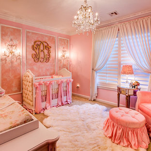 Design ideas for a large shabby-chic style nursery for girls in Oklahoma City with pink walls, carpet and beige floors.