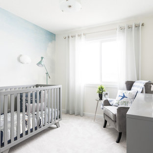 This is an example of a contemporary gender-neutral nursery in Edmonton with blue walls, carpet and white floor.