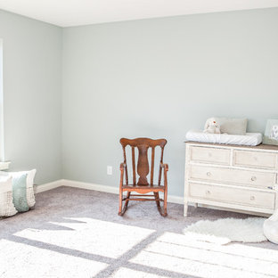 Example of a small cottage gender-neutral carpeted nursery design in Louisville with green walls